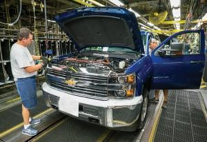 An analysis from economists at the University of Michigan found that Michigan as a state would fare better than the national economy if the U.S. were to pull out of NAFTA. In part, that's because the state's major export, light vehicles and especially trucks, could benefit from tariff protection. A Chevrolet Silverado assembly line in Flint is shown above.