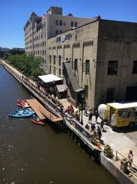 Milwaukee's Lakefront Brewery features outdoor seating along the city's RiverWalk, as well as docks for boaters and kayakers. The $52 million RiverWalk, built through a series of public-private partnerships, spans more than 20 blocks through the city and has become a focal point of development.