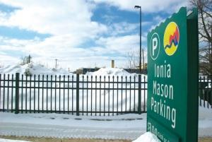 The city of Grand Rapids' Ionia-Mason lot was built at a cost of $1.8 million in 2010 in anticipation of a condo development that never materialized. Now, the city is using the lot as a dumping ground for snow it removed from other well-used lots in the city's downtown.