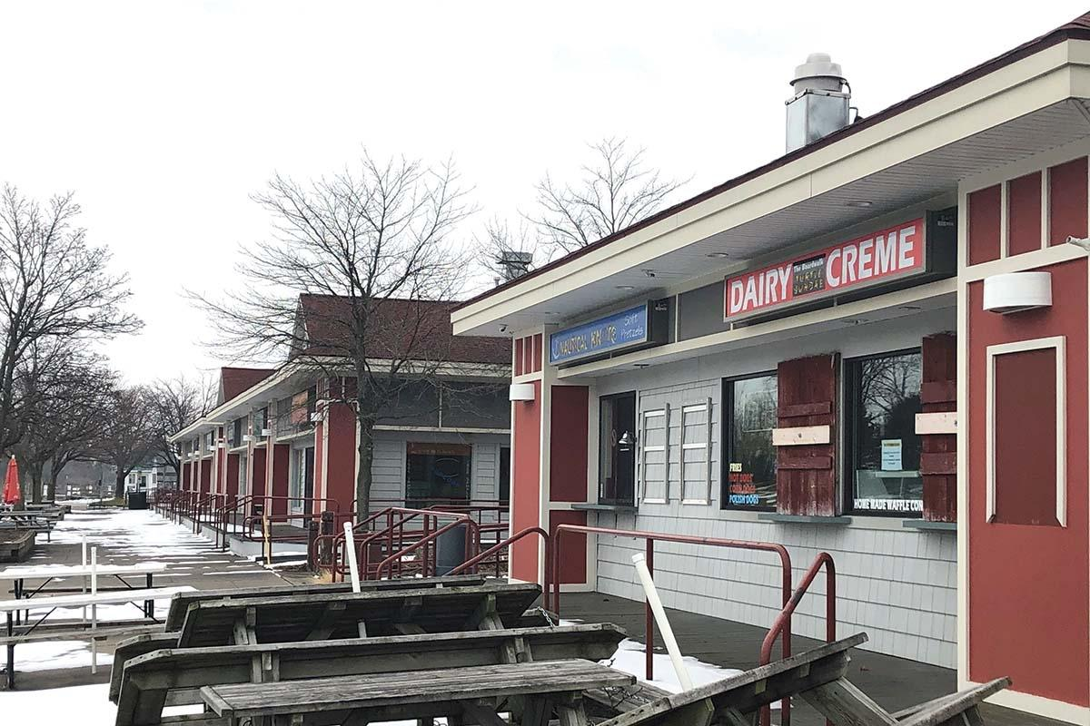 The City of Grand Haven, which owns retail buildings along Chinook Pier, will have to demolish the facilities after high water levels caused flooding and led to mold.