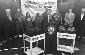 U.S. Sen. Gary Peters discusses legislation to increase the use of remanufactured parts in repairing the federal fleet during a stop in March at North American Fuel Systems Remanufacturing in Kentwood