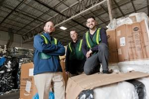 "The family-owned Padnos Plastics Solutions' conservative culture has it focusing on organic growth ""in a way we can handle,"" said Ben Irwin, the company's director of finance, left. Padnos recently reached capacity at its 44th Street location in Wyoming, which handles plastic and scrap metal recycling. The recycler opted to expand by buying a facility in Fremont, Ind. to be close to customers and the Interstate 80/90 corridor. Irwin is shown with Randy Knibbe, center, and Jonathan Padnos, right."