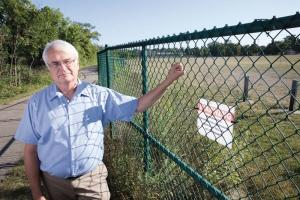 GVSU scientist Richard Rediske stands at the border of Wolverine World Wide's former tannery site in Rockford.