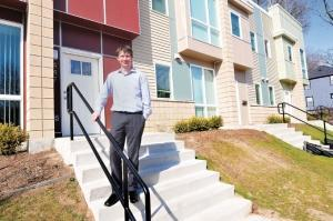 Jeremy DeRoo, co-executive director at LINC Community Revitalization Inc., in front of the Southtown Square development in the Madison Square neighborhood of Grand Rapids.