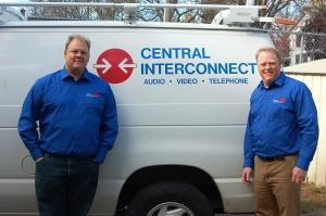 Wade Thompson (left) and Neil Brown pose with one of the service vans that Central Interconnect uses to service customers throughout West Michigan.