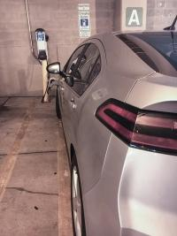 A Chevrolet Volt charges using a ChargePoint station located in the city-owned Ottawa Fulton Parking Ramp in Grand Rapids.