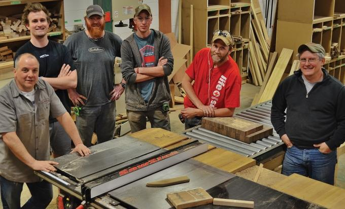 Cento Anni LLC employs eight full-time workers at its woodshop in Holland. The company works with students in the West Ottawa Intermediate School District to teach the woodworking trade. Founder Ed DeNave (far left) said he hasn't had trouble finding workers as the company mostly targets people willing to learn the trade.