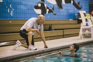 "David Clark's ""Encore"" career led him to the Forest Hills YMCA, where he serves as a volunteer on the pool deck. Clark was formerly a swim coach and physical education instructor at Grand Rapids Junior College."
