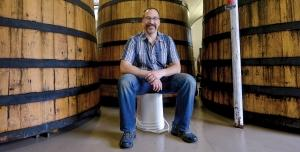 "Rather than work to spread its beer far and wide, Brewery Vivant wants to solidify its position as a local brewery with a small distribution footprint, according to co-founder Jason Spaulding, shown here in the company's foeder room, where it makes sour beers. ""Brewers that want to grow are going to have to have a terrific product, have the sales team to deliver the message, and the infrastructure to push their beer into the market to succeed,"" he said."
