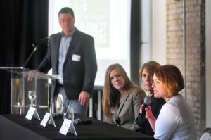 Heather Brazee of Herman Miller speaks during the panel discussion of the West Michigan's Healthiest Employers event. (R-L) Barbara Witt (Trendway), Amanda Harrison (Southwest Michigan First) and MiBiz's Mark Sanchez listen.