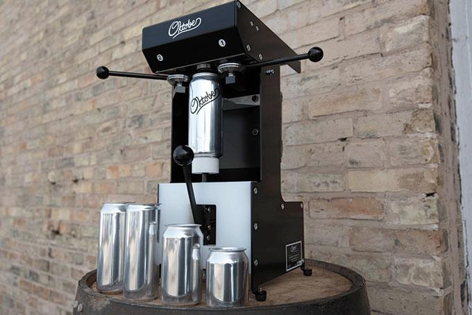 Muskegon-based Oktober LLC works with West Michigan manufacturers to make parts for its Mk 16 Canseamer, which it assembles in-house. The machine allows brewers to seam or seal aluminum cans of beer filled directly from the tap. The company was founded by three engineers who studied together at Michigan Tech, worked in various industries and later reconnected to start the venture. Since September, the company has sold nearly 300 units at $1,500 apiece.