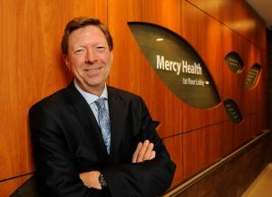 Why does Mercy Health's CEO want empty hospital beds?