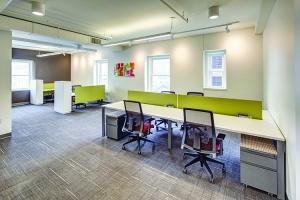 West Michigan's office brokers and developers have had success with smaller, amenity-driven space geared toward tenants with a need for flexibility. For example, Blue35 in downtown Grand Rapids, pictured here, leases a wide variety of modern office spaces, offering everything from a desk for a day to a whole floor.