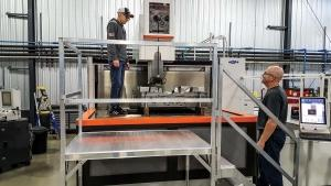 Extreme Wire EDM Service Inc. in Grandville just installed a new machine capable of handling 4-foot by 8-foot molds. It uses electrical current to machine material to tolerances less than one-fifth the width of a human hair.