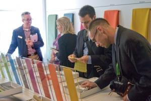 Industry professionals talk with Steelcase representatives about new fabrics at the 2014 NeoCon trade show in Chicago earlier this month.