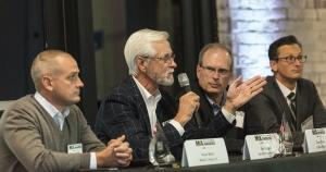 Participating in the best practices panel discussion at the 2016 M&A Deals and Dealmakers of the Year Awards were (from left) Ryan Mast of Bloem LLC; Jim Engen, the founder of Netech; Tom Olive, the CEO of Crystal Flash; and Mike Jones, a partner at Warner Norcross & Judd.