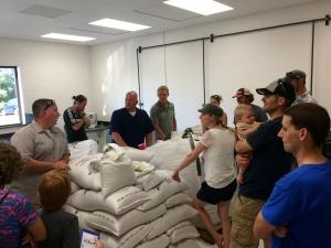 Pilot Malt House owner Erik May leads a tour of the Byron Center facility earlier this year.