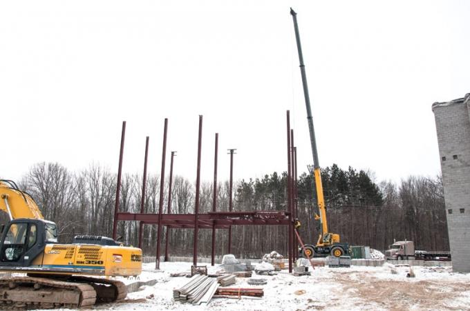 Crews from Rockford Construction continue to work on the new Donald W. Maine College of Business facility at Davenport University's campus in Caledonia. The $15.5 million, three-story building is one of several projects the university has taken on in recent years despite losing one-third of its student body.