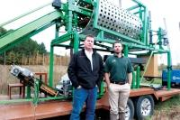 Cory Deeds, right, at E-Motion Controls developed the concept behind the Humulus 1500P, a portable hop harvester. He worked with Todd Vriesenga, left, at Perceptive Concepts to further design the equipment, which was then built by Innertool of Cadillac.