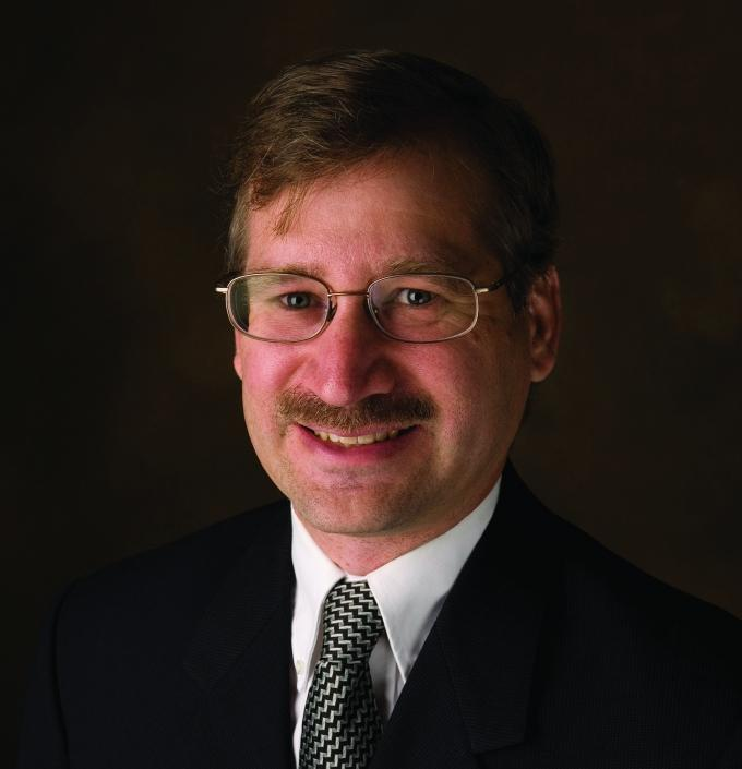 Paul Isley, Associate Dean and a professor of economics at the Grand Valley State University Seidman College of Business