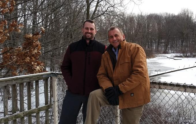 Jason Meyer of Blandford Nature Center, left, and Joe Engel of the Land Conservancy of West Michigan, right, have partnered to acquire the 121-acre Highlands Golf Course, with plans of restoring the property to its natural setting and opening it to the public.