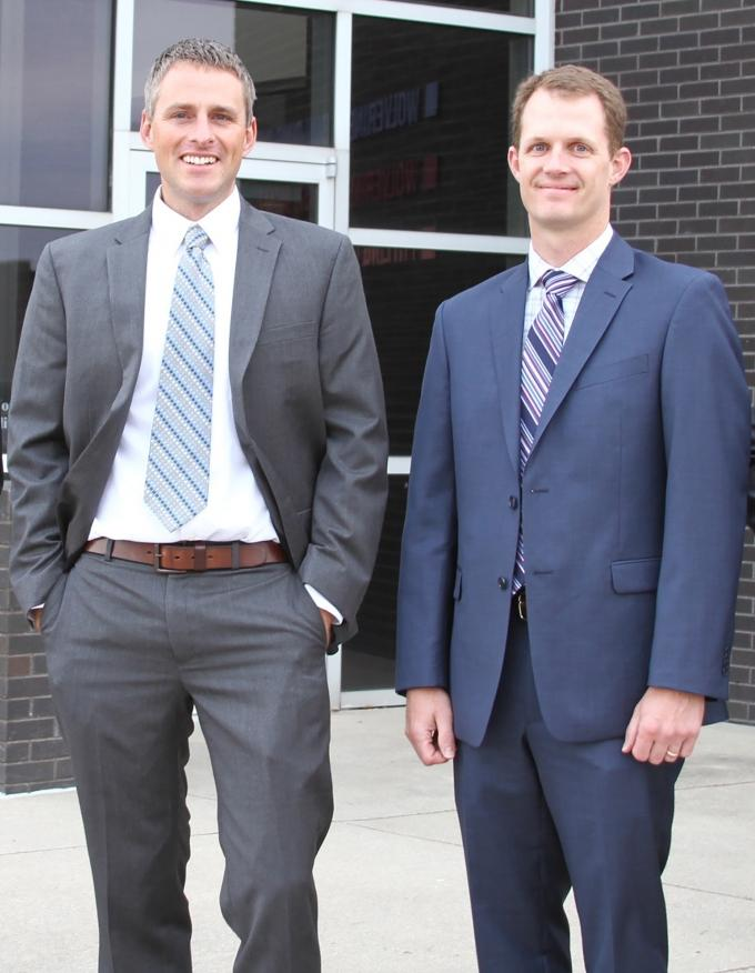 Aaron Jonker, left, and Curt Mulder, right, transitioned into leadership roles at Grand Rapids-based Wolverine Building Group over an 18-month period. The length of the process and their communication with employees helped to avoid disruptions at the general contracting firm.