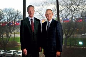 Steve Van Andel, left, will step down from day-to-day management of Amway at the end of 2018. He serves as co-CEO with Doug DeVos, right.