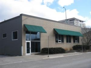 Merchandising firm buys near-downtown Grand Rapids office building.