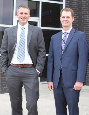 Aaron Jonker, left, and Curt Mulder, right, took over Wolverine Building Group.