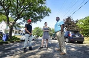 As investors flock to new Grand Rapids neighborhoods in search of housing deals, their sometimes aggressive acquisition tactics have become the targets of criticism from longtime residents and community activists. Stakeholders say it's important for residents to stay invested in the community if they want to be a part of shaping its future. Pictured (l-r): Jonathan Jenks, Sarah Scott and Jamiel Robinson
