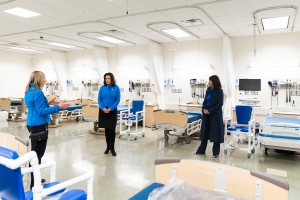 Spectrum Health CEO Tina Freese Decker, Gov. Gretchen Whitmer and GVSU President Philomena Mantella talk in the university's Cook-DeVos Center, where Spectrum Health has installed beds and equipment to deal with an expected surge of COVID-19 patients.