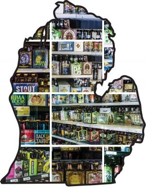 The crowded shelves of craft beer at Riverside Liquors in Grand Rapids.