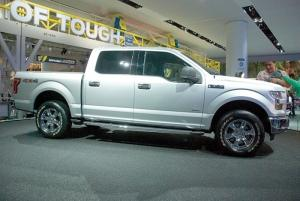 The 2015 Ford F-150 will feature aluminum body panels, a first in the segment and the first time the material is getting widespread use among mainstream automakers. By switching to aluminum and using more high-strength steel in the frame, Ford was able to shed between 550 and 700 pounds from the current F-150 model and downsize its engine while becoming more efficient and maintaining the truck's capabilities.