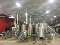 New legislation would expand the Michigan Grape and Wine Industry Council to include representation from other types of craft beverage makers in the state. However, some types of producers say they had hoped the legislation would give them a dedicated seat on the new Michigan Craft Beverage Council. Pictured is Vander Mill LLC's new Grand Rapids cider production facility.