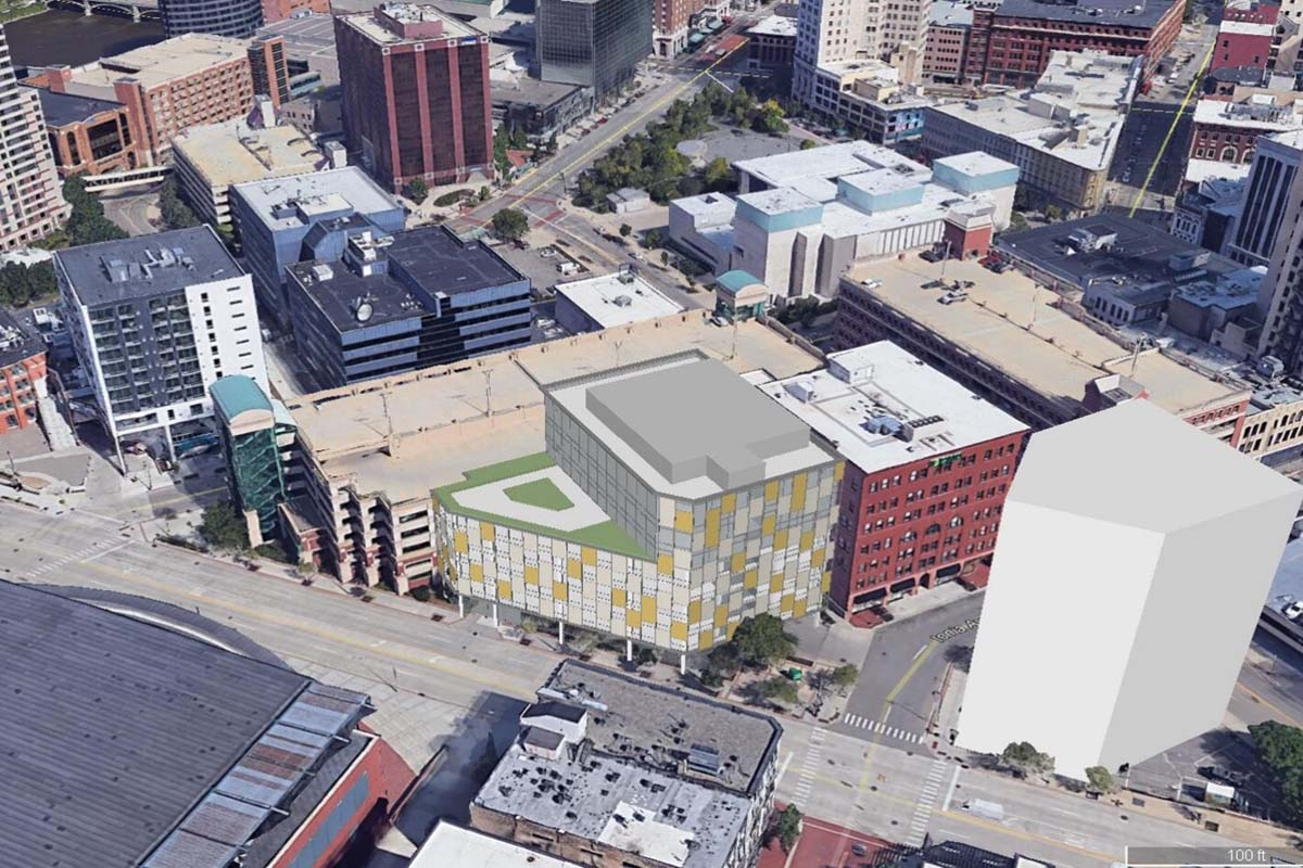 Renderings show a concept for a five-level, 165-space parking facility proposed for an existing surface parking lot adjacent to the existing Fulton-Ottawa ramp in Grand Rapids.