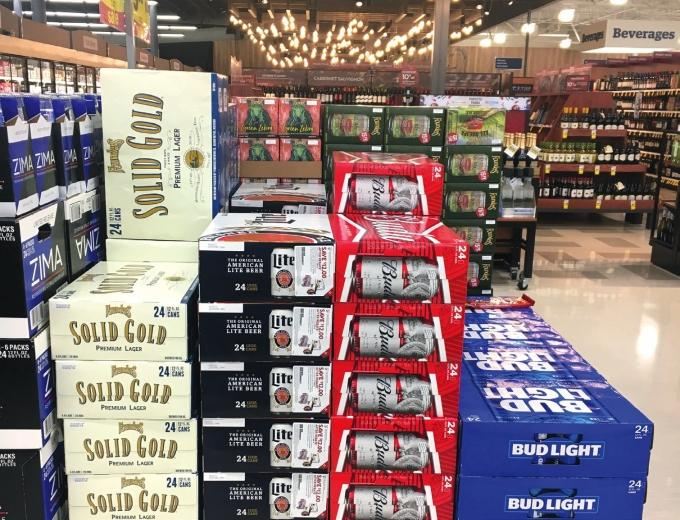 With competitive pricing and strategic product placement for its 24-packs of Solid Gold, Founders Brewing Co. appears to be aiming to lure more macro beer drinkers to try craft beer.
