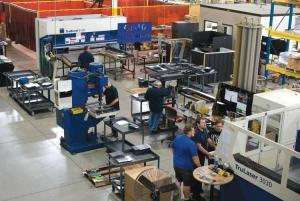 Furniture suppliers across West Michigan are bracing for a period of increased demand by adding capacity through acquisitions, turning to automation or providing additional training to employees. The OMT-Vehyl plant in Zeeland, which makes table legs and bases, is shown.