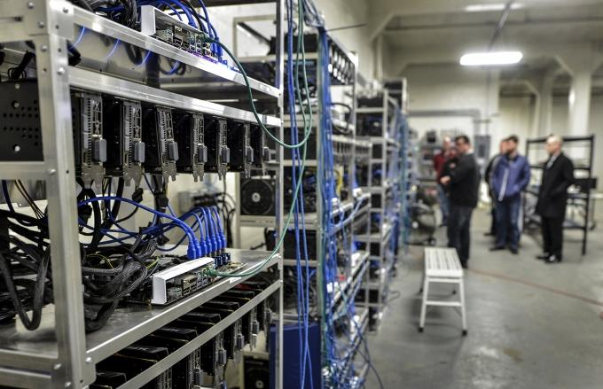 Ensource Capital's proprietary computer rigs line a warehouse space in Wyoming where the company is investing in additional blockchain mining technology.